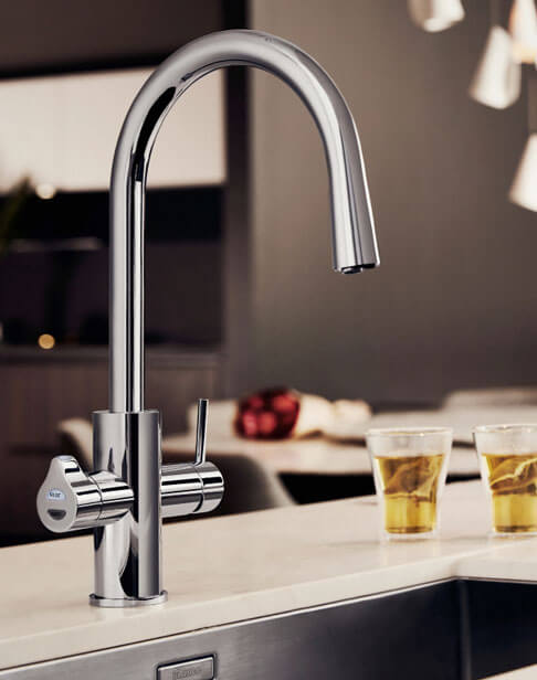 White All-In-One Celsius Arc Tap in a kitchen