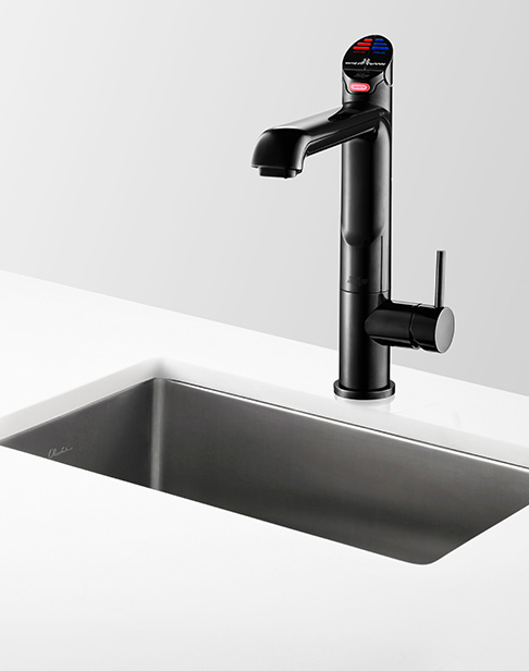 Black All-In-One Tap next to a kitchen sink