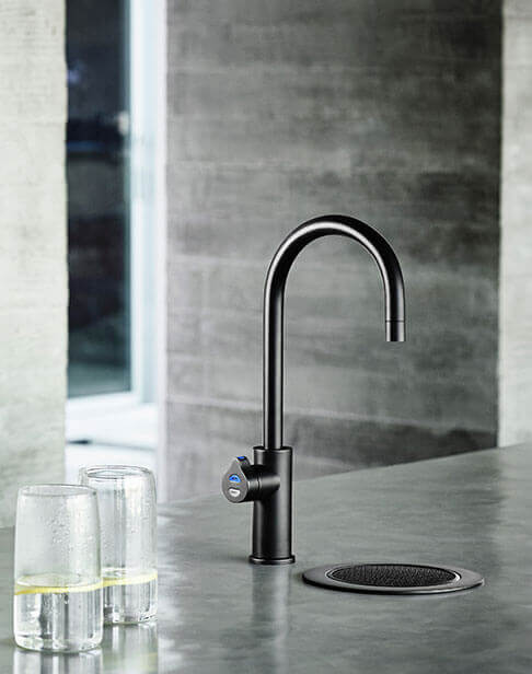 Black HydroTap installed on a font in a modern kitchen