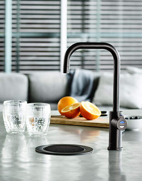Black Cube HydroTap installed on a font