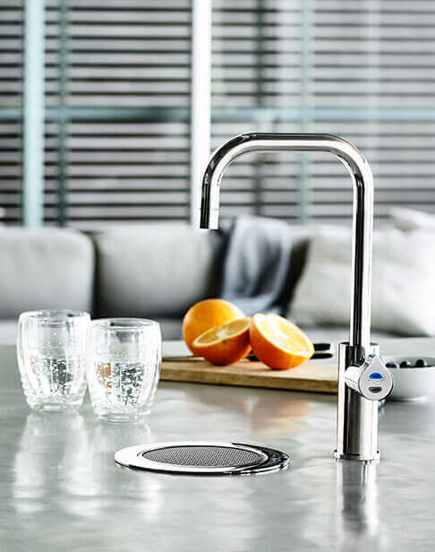 Chrome Cube HydroTap installed on a font